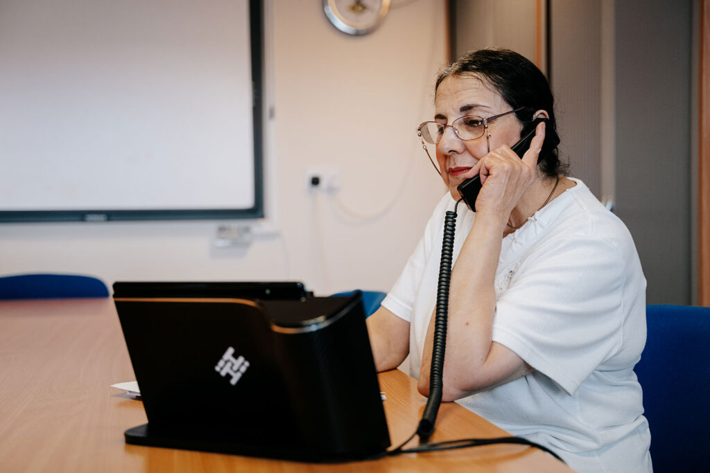 AFTB employee talking on a telephone.
